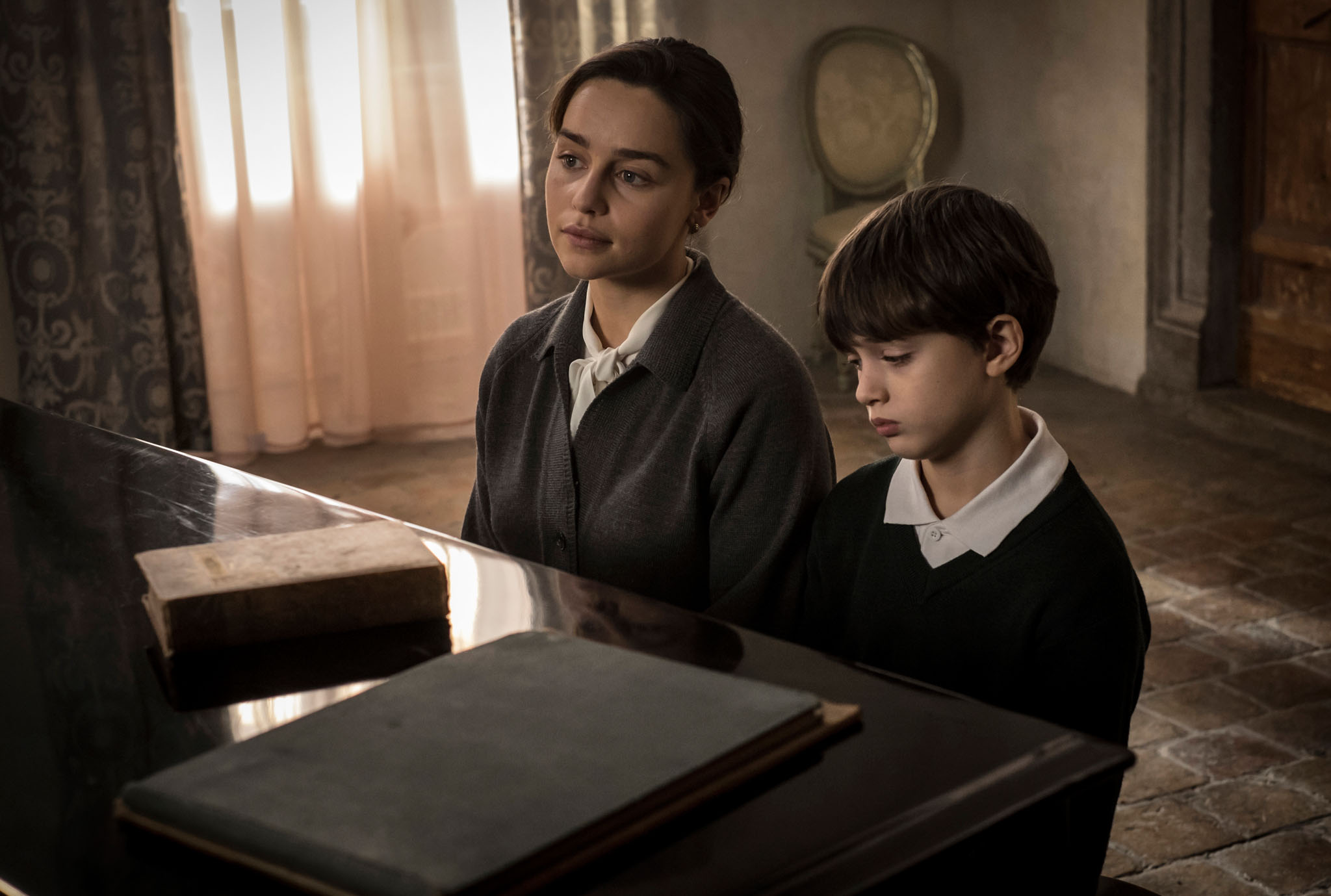 Emilia Clarke at piano with Edward Dring